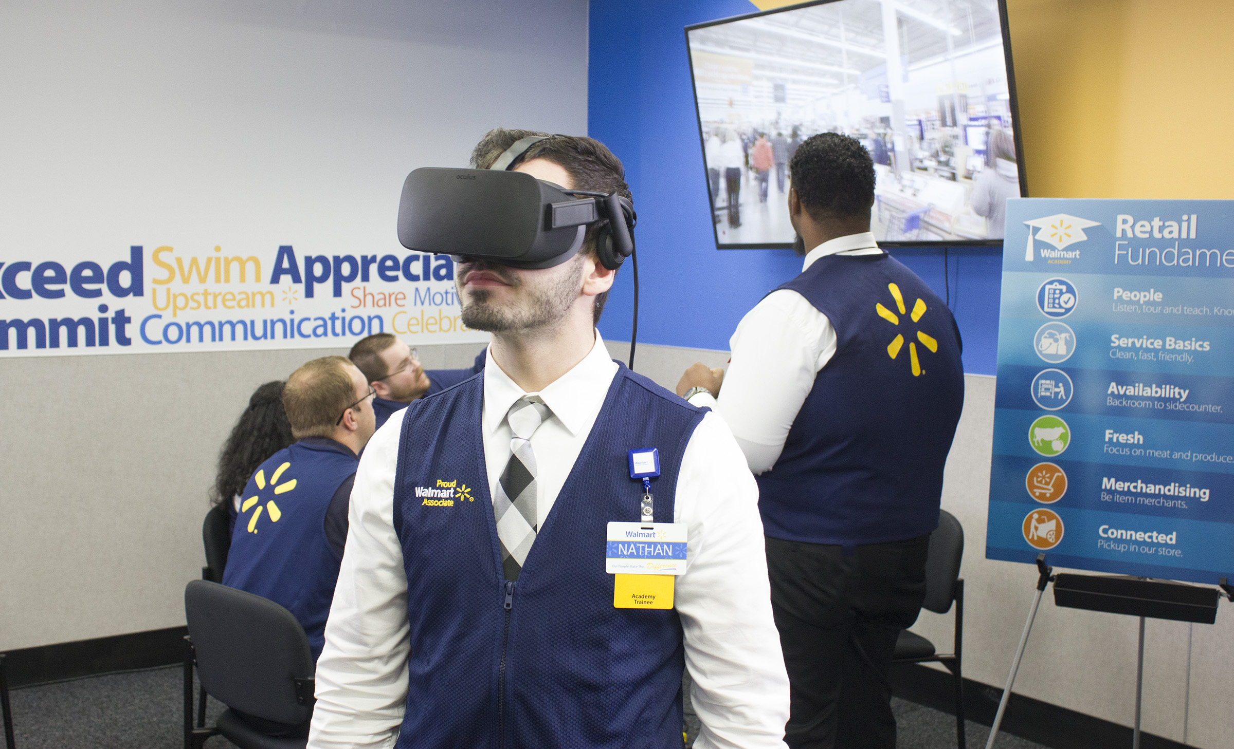 New WalMart employee completing orientation using a virtual reality headset